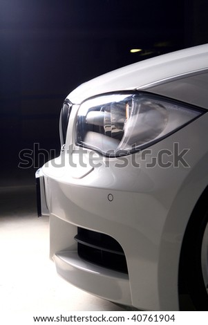 white car on black background - stock photo