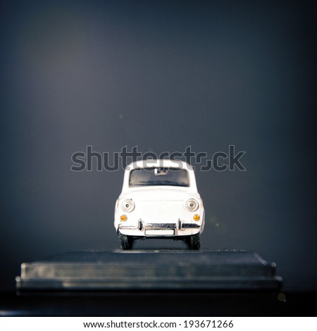 White car over dark background. - stock photo