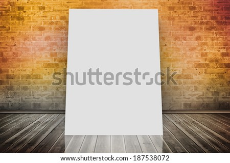 White card against room with brick wall