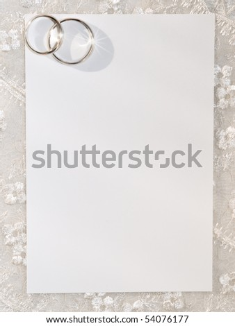 White card for congratulation with rings on a background from lace - stock photo