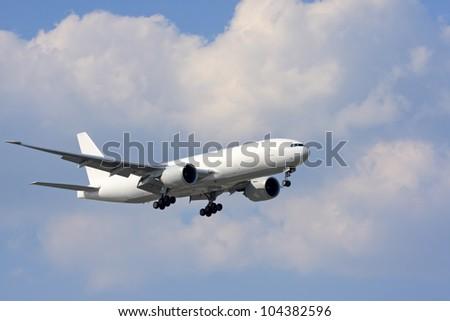 White cargo airplane during landing - stock photo