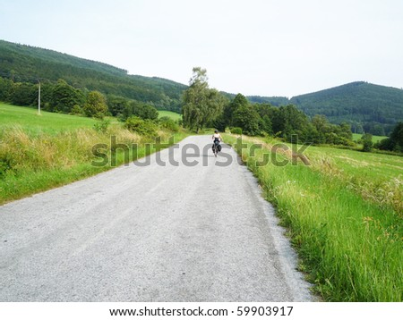 White Carpathians landscape on the border between Czech Republic and Slovakia - with asphalt road - stock photo