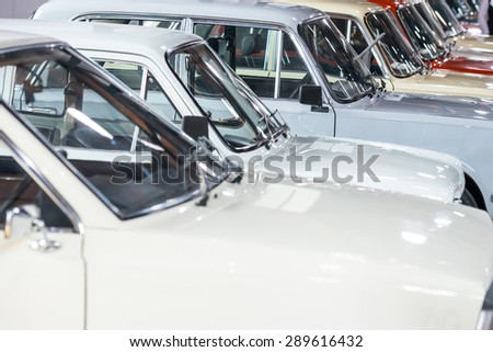White cars in a row on parking lot  - stock photo
