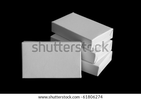 White carton boxes isolated on black background - stock photo
