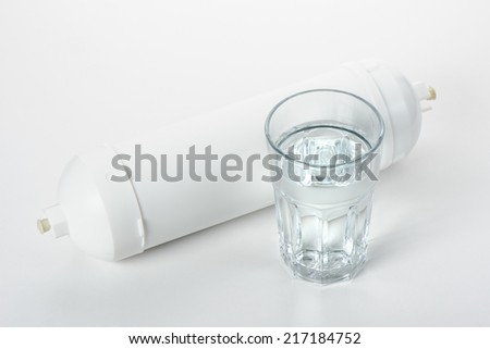 white cartridge for water filtration on white background - stock photo