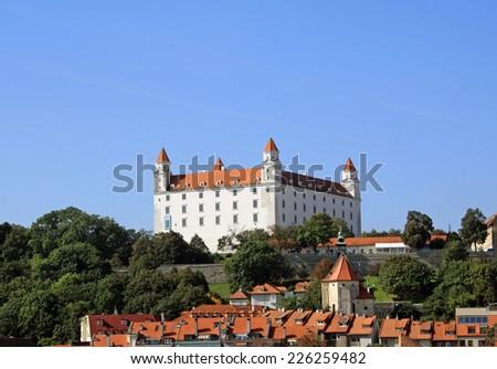 White castle on the hill in Bratislava - stock photo