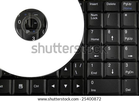 White CD on a laptop keyboard