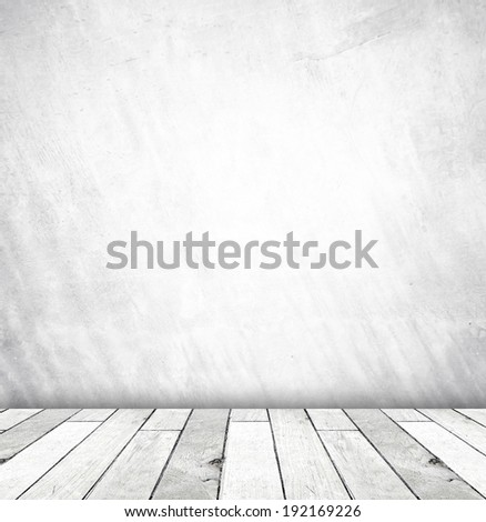 White cement wall and old wood floor, empty perspective room in light tone.
