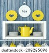 White ceramic kitchenware on the shelf in front of blue, old wood wall. - stock photo