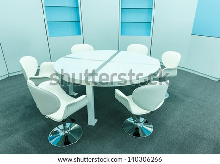 white chair and tables set for reading and book shelf in the empty library - stock photo