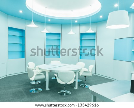 white chair and tables set for reading with ceiling lamp in the empty library - stock photo