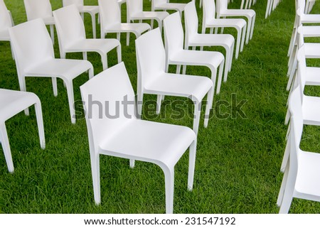 White chair on green grass - stock photo