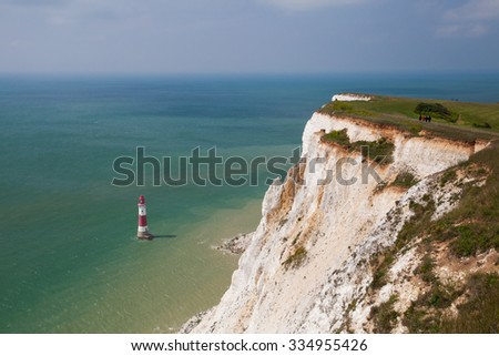White chalk cliffs and aerial view Lighthouse Beachy Head, Eastbourne, East Sussex, England - stock photo
