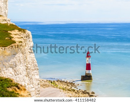 White chalk cliffs and Beachy Head Lighthouse Eastbourne, East Sussex, England - stock photo