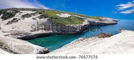 white chalk cliffs eroded coastline blue sky and sea at Caterina di Pittinuri Sardinia Italy panorama landscape beautiful travel holiday vacation natural tourism attraction impressive rock formation