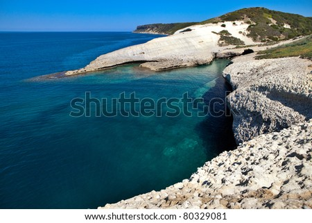 white chalk cliffs eroded coastline blue sky and sea at Caterina di Pittinuri Sardinia Italy landscape