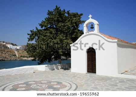 White chapel in Rhodes, Greece near small city of Lindos.