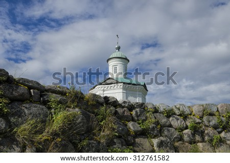 White chapel on the edge of the cliff (Russia, Arkhangelsk region, Solovki)