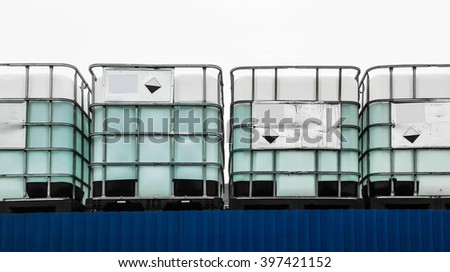 White chemical container on a blue wall - stock photo
