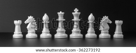 White chess figures isolated on the black background. Set of chess figures. - stock photo