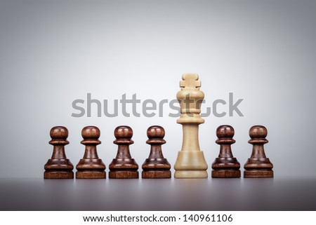 white chess king leadership concept over grey background - stock photo