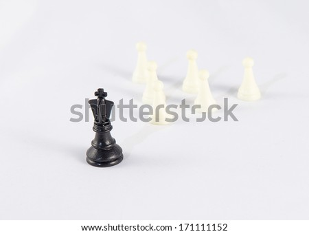 White chess king with black pawns symbolizing business leadership and difference