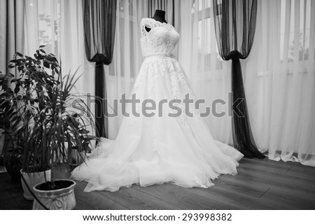 white chic wedding dress on the mannequin