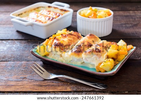 White chicken meat stuffed with ham and melted cheese,selective focus on the front plate - stock photo