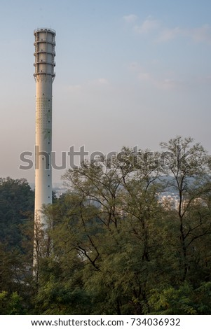 White chimney  September 30, 2017 which was taken in the fall. A white chimney with a tree attracts attention.