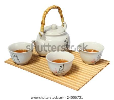 White Chinese tea set on a white background - stock photo