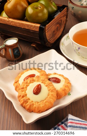 White chocolate almond cookies on a plate - stock photo