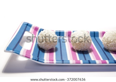 white chocolate balls with coconut - isolated on white background - stock photo