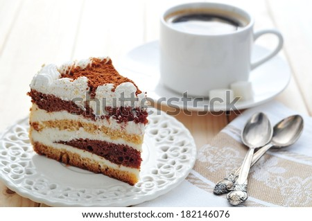 White chocolate cake and cup of coffee or tea