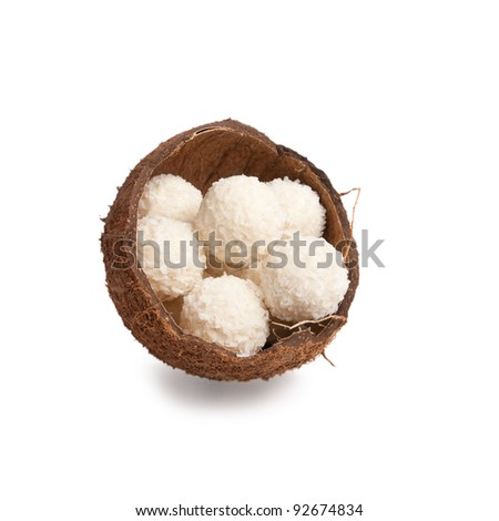 white chocolate truffles in a box of coconut halves isolated on white background - stock photo