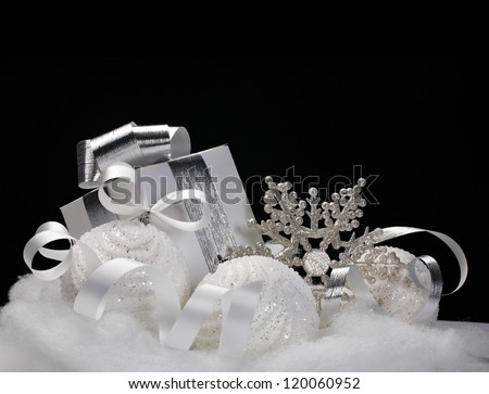 White Christmas balls, gift, snowflake - still life on black background - stock photo