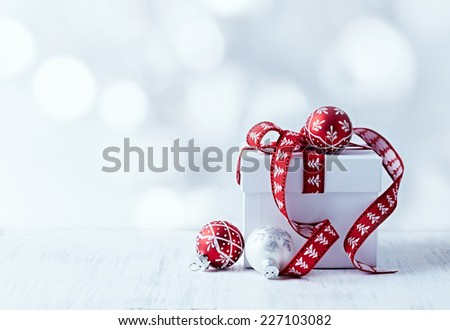 White Christmas gift with red ribbon  - stock photo
