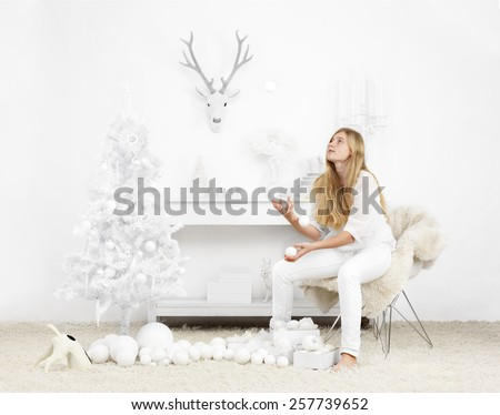 white christmas setting with girl waiting for the holidays to start