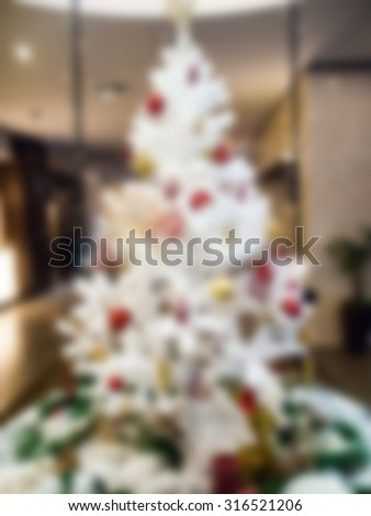 White christmas tree blurred background for Christmas - stock photo