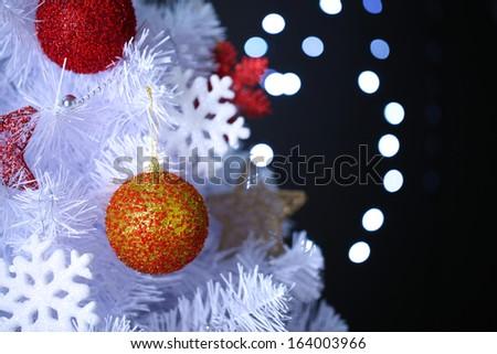 White Christmas tree on bokeh background - stock photo