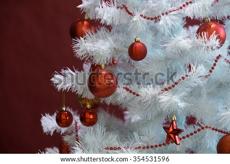 White Christmas tree with red balls - stock photo