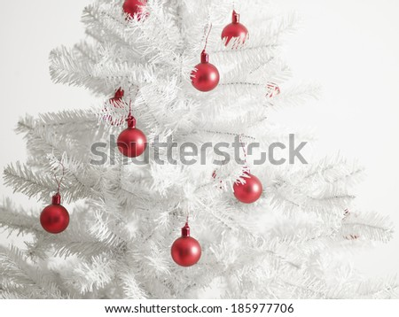 White Christmas Tree with Red Baubles - stock photo