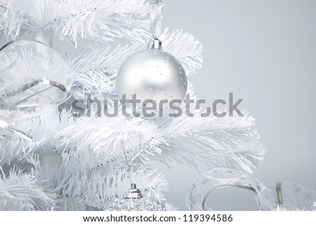 white christmas tree with silver decoration closeup studio shot - stock photo