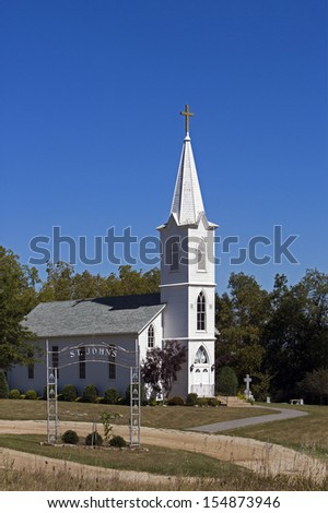 White church and blue sky - stock photo
