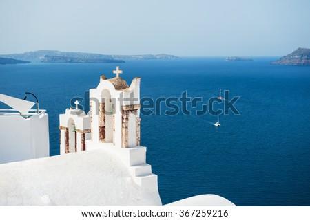 White church in Oia town on Santorini island, Greece. Beautiful landscape with sea view - stock photo