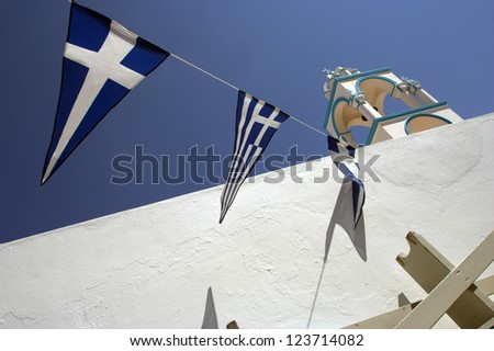 White church with Greek flags - stock photo