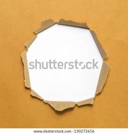 white circle shape breakthrough beige paper hole - stock photo