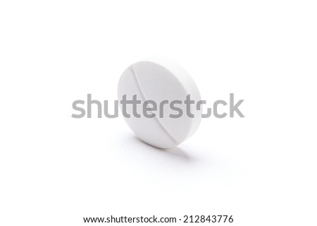 White circular tablet, isolated. Healthcare concept. - stock photo