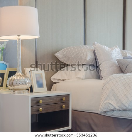 white classic lamp on table side in bedroom