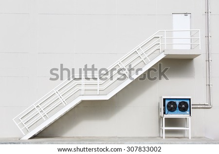White clean metal stairs on concrete wall