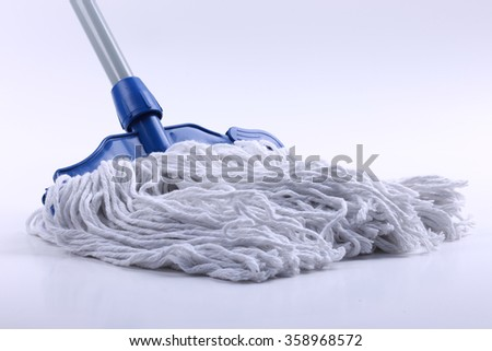White cleaning mop isolated on white background. - stock photo
